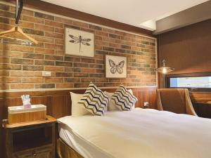 好眠Homie民宿 房間的床