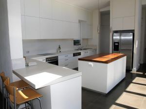 A kitchen or kitchenette at 8 ON COAST (4 night min)
