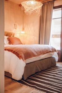 A bed or beds in a room at Nomad Hotel - Xábia Port