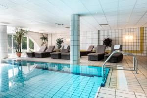 The swimming pool at or near WestCord Hotel Schylge