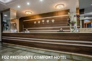The lobby or reception area at Foz Presidente Comfort Hotel