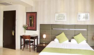 A bed or beds in a room at National Hotel - Jerusalem