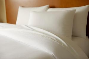 A bed or beds in a room at Hyatt House San Juan