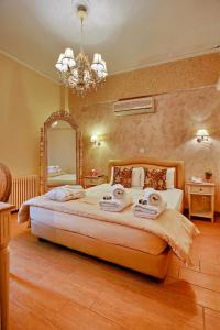 A bed or beds in a room at Anixi Vintage Hotel