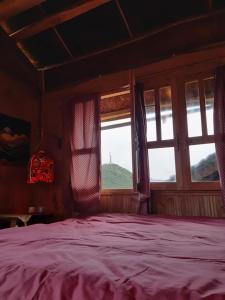 Giường trong phòng chung tại Homie homestay