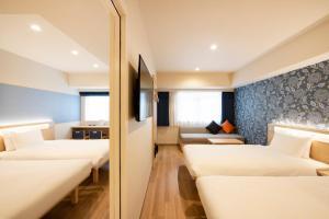 A bed or beds in a room at karaksa hotel TOKYO STATION