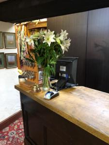 The lobby or reception area at The Dog & Partridge Country Inn