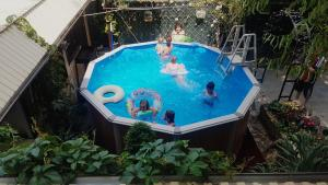 A view of the pool at Guest house Sibiriachka or nearby