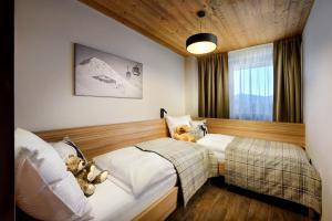 Posteľ alebo postele v izbe v ubytovaní Chalet Norvinga Jasná