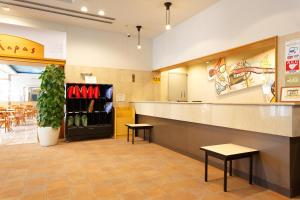 The lobby or reception area at HOTEL S&S MORI TOWN