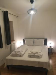 A bed or beds in a room at Nová Pec Holiday Resort Lipno