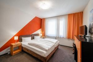 Ein Bett oder Betten in einem Zimmer der Unterkunft Aparthotels Münzgasse An der Frauenkirche