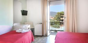 Letto o letti in una camera di Hotel Al Gabbiano