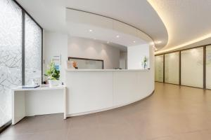 The lobby or reception area at All Suites Bordeaux Pessac