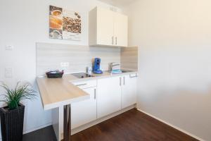 Küche/Küchenzeile in der Unterkunft Mein Appartement Hürth Köln
