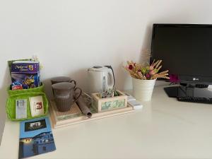 TV a/nebo společenská místnost v ubytování Monte Maino Bed & Breakfast