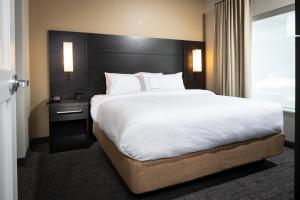 A bed or beds in a room at Residence Inn Las Vegas South/Henderson