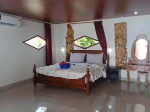 En eller flere senge i et værelse på Lamai chalet Koh Samui
