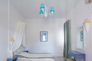 Un ou plusieurs lits dans un hébergement de l'établissement Meltemi Village Hotel