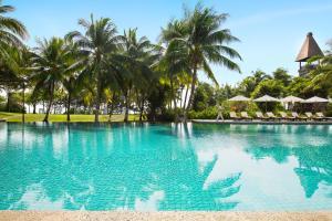 The swimming pool at or near Raffles Hainan