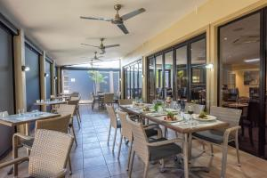 A restaurant or other place to eat at Coral Cay Resort