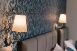 Cama o camas de una habitación en Melrose House Hotel