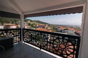 Un balcón o terraza de Melrose House Hotel