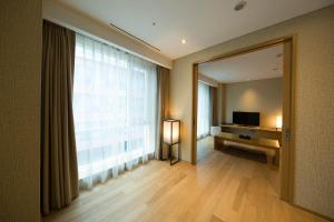 A television and/or entertainment center at Solaria Nishitetsu Hotel Busan