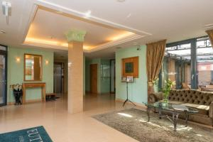 The lobby or reception area at Euterpe Hotel