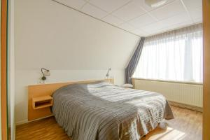 A bed or beds in a room at Appartement 5