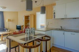 A kitchen or kitchenette at Appartement 5
