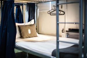 A bed or beds in a room at Nomada Urban Beach Hostel