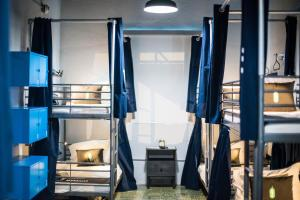 A bunk bed or bunk beds in a room at Nomada Urban Beach Hostel