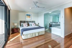 A bed or beds in a room at Sea View Shorelines Hamilton Island