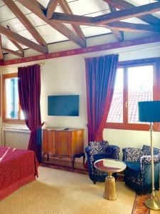 Area soggiorno di Hotel La Calcina