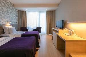 A bed or beds in a room at Spa Tervise Paradiis