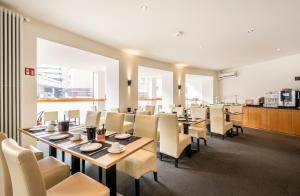 Ein Restaurant oder anderes Speiselokal in der Unterkunft Hotel Oltnerhof