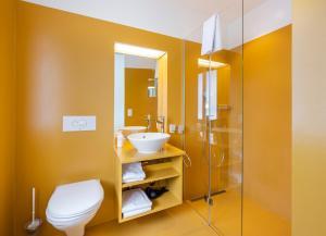 Ein Badezimmer in der Unterkunft Hotel Oltnerhof