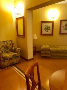 Ein Sitzbereich in der Unterkunft Residenza d'Aragona
