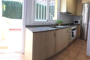 A kitchen or kitchenette at HORTAS HOUSE FULLY EQUIPPED SPACIOUS TWO BEDROOM HOUSE with ROOF TERRACES Ref MRHAE