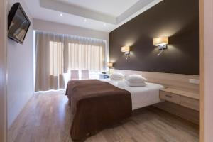 A bed or beds in a room at Spa Tervis