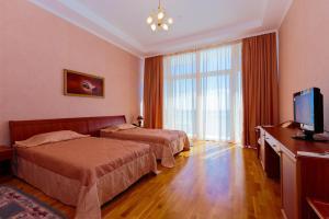 Кровать или кровати в номере Отель Белый Грифон