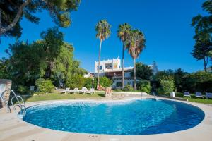 The swimming pool at or near Suites Cortijo Fontanilla