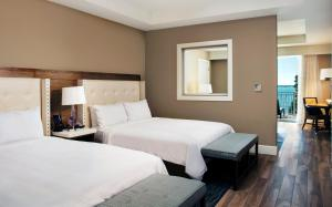 A bed or beds in a room at Playa Largo Resort & Spa, Autograph Collection