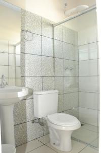 Um banheiro em Pousada Ponto Chic