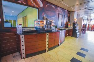A kitchen or kitchenette at Best Western Hotel Groningen Centre