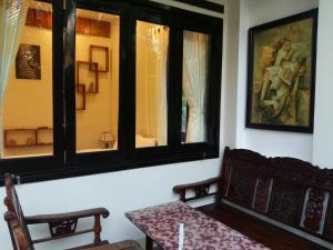 A seating area at CoCo Riverside Homestay
