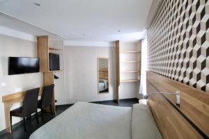 Cama ou camas em um quarto em Hotel des Pyrénées