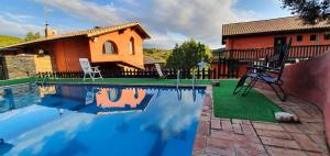 The swimming pool at or near Hostal Rural Casa Pedro