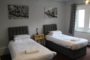 A bed or beds in a room at The Royal Oak